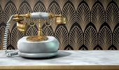 picture of embellish  - A vintage marble and brass telephone with a handset and dial embellishments on a marble shelf on an art deco wallpaper background - JPG
