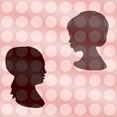 foto of rayon  - Two heads silhouettes on vintage polka dot gradient background - JPG