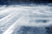 image of dangerous  - Icy Road with Drifting Snow Closeup - JPG