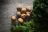 stock photo of kale  - Mixed vegetables on wood including mushrooms - JPG