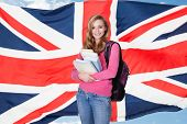 pic of citizenship  - Portrait Of Young Female Student Holding Books In Front Of Usa Flag - JPG