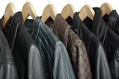 picture of jacket  - collection of leather jackets on hangers closeup - JPG