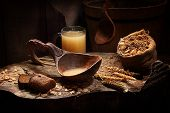 stock photo of ladle  - kvass in a wooden ladle and in a transparent mug - JPG