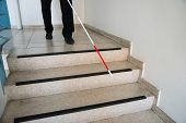foto of stairway  - Blind Man Moving Down On Stairway Holding Stick - JPG