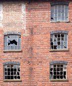 picture of derelict  - Broken windows in an old derelict building - JPG