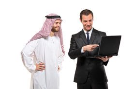 image of arab man  - Happy businessmen with a laptop computer against white background - JPG