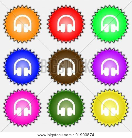Headphones, Earphones  Icon Sign. A Set Of Nine Different Colored Labels. Vector