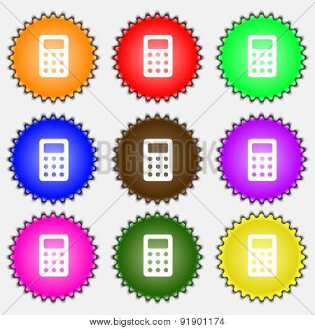 Calculator, Bookkeeping  Icon Sign. A Set Of Nine Different Colored Labels. Vector
