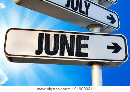 June direction sign with a beautiful day