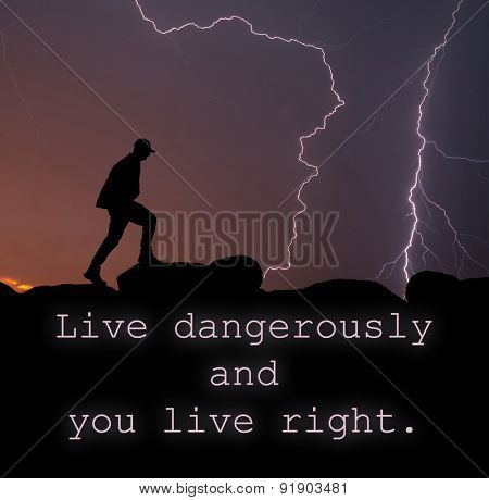 Live dangerously and you live right - quote with a silhouette of a man walking on top of a mountain, with lightning strikes across the sky