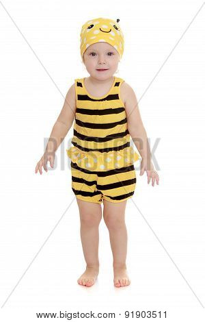 Adorable little girl in a striped bee costume