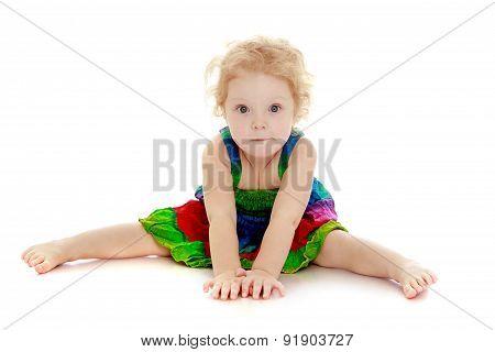 Cute little girl sitting on the floor