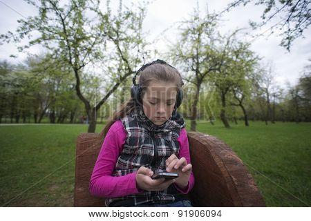 Girl In Headphones Texting