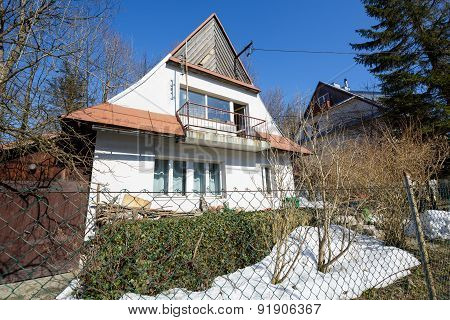 House Covered With A Sloping Roof