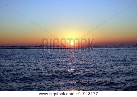Boats In The Water During Sunset Over The Ocean