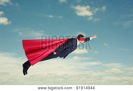 superhero flying high in the sky