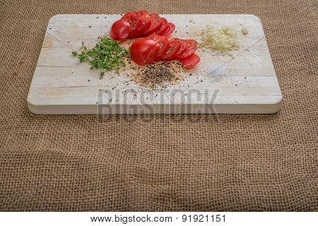 Aerial View Tomatoes Cress Garlic Salt Pepper On Burlap Background