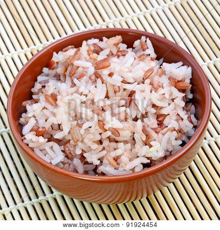 Mixed white and red coarse rice.