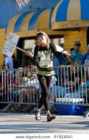 Woman Wears Spelling Bee Costume In Miami Mango Strut Parade