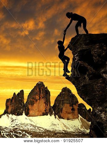 Silhouette of girls climbing on the rock. In the background Tre Cime di Lavaredo.