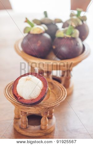 Group Of Mangoesteen On Wooden Tray