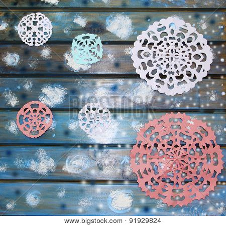 Picturesque Paper Snowflakes On A Blue Wooden Table, A Christmas Background
