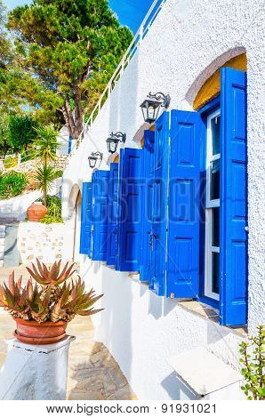 Iconic blue wooden shutters in Greece