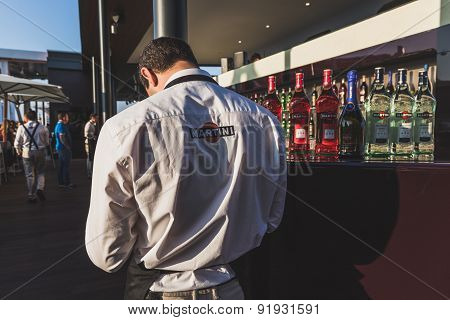 Waiter Working On Martini Terrace At Expo 2015 In Milan, Italy