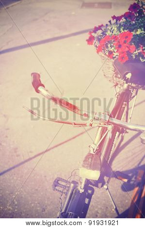 Vintage bicycle with beautiful flowers, romantic scenery