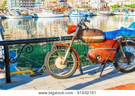Old rusted motorbike in small part of Kalymnos