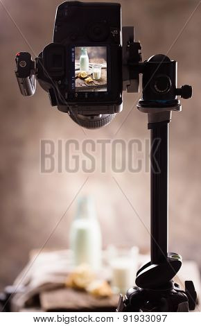 Photographing still-life with a bottle of milk