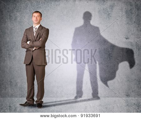 Businessman with shadow in cape