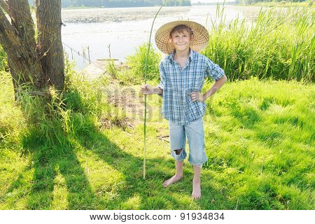 Smiling Angling Teenage Boy With Handmade Green Twig Fishing Rod In Hand