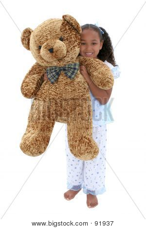 Beautiful Six Year Old Girl In Pajamas With Giant Teddy Bear