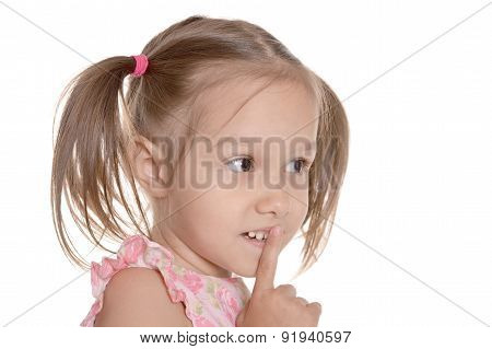 Little girl showing hush sign