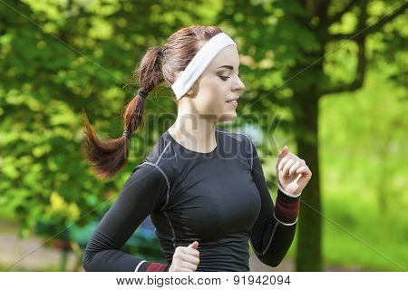 Portrait Of Smiling Caucasian Sportwoman Having Her Regular Training Outdoors.