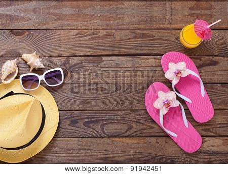 Trendy summer accessories on wooden background pool.