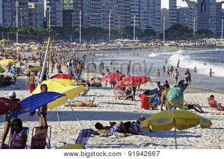 People Enjoying The Copacabana Beach In Rio De Janeiro Brazil