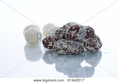 Belgian Chocolate Candies In Front Of Coconut Balls