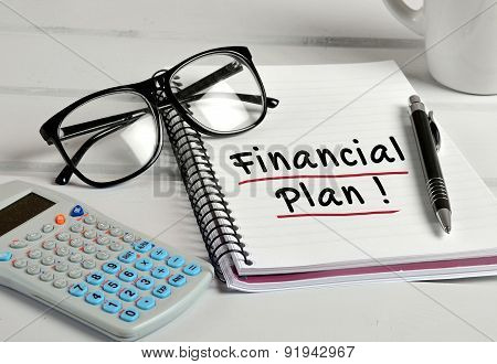 Financial Plan Word On Notebook