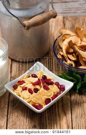 Upper View On Square Bowl Full Of Cornflakes With Berries