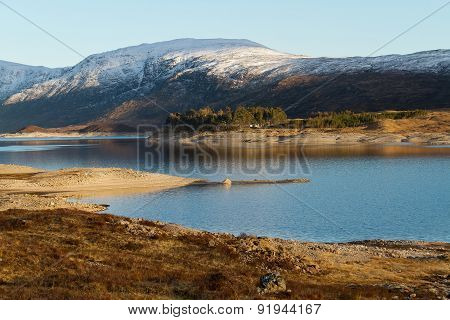 An Amazing Scenic View Of A Lake Infront Of A Mountain In The North Of Scotland