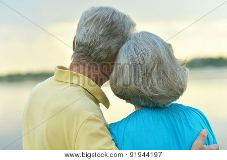 Mature couple in love at sunset