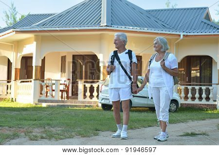couple standing embracing outdoors