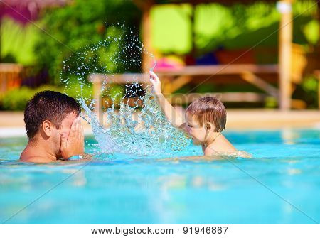 Joyful Father And Son Having Fun In Waterpark Pool, Summer Holidays