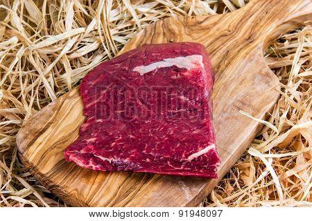 British Beef Flat Iron steak on cutting board and straw