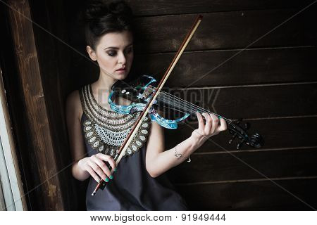 girl posing and holding a violin