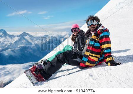 Young couple enjoying winter mountains