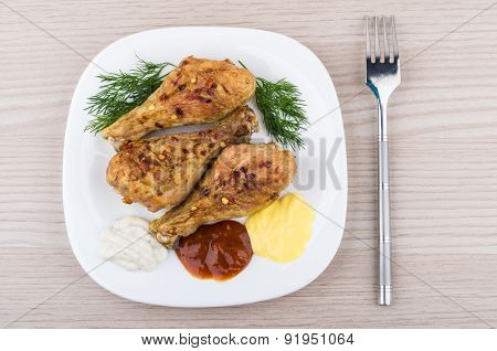 Three Fried Chicken Legs With Dill In Glass Plate