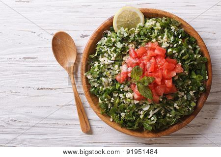 Tabbouleh Salad In A Wooden Bowl. Horizontal Top View